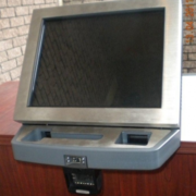 Wall mounted biometric and scanning terminal.